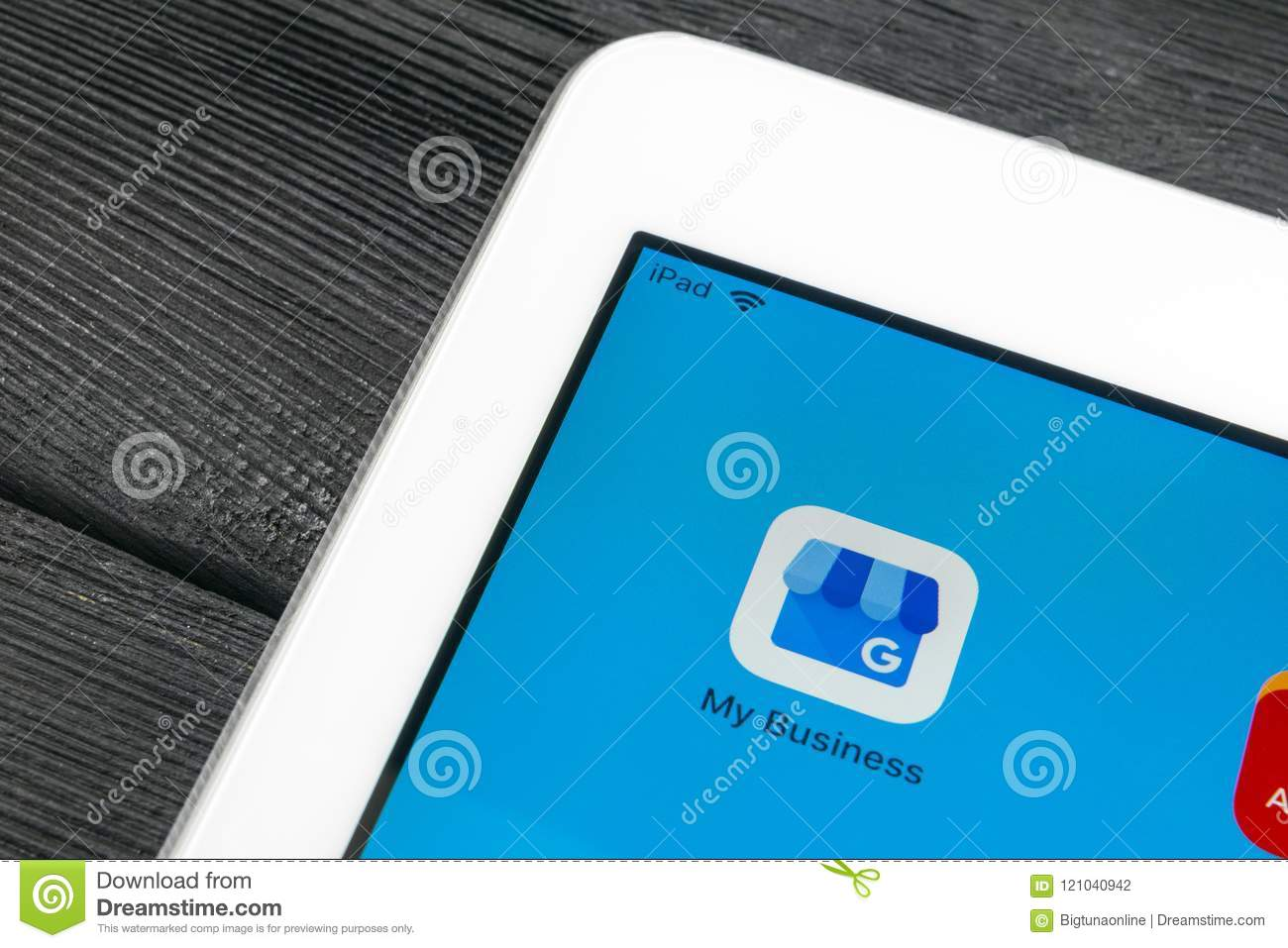 Google My Business application icon on Apple iPad Pro screen close-up. Google My Business icon. Google My business application. So
