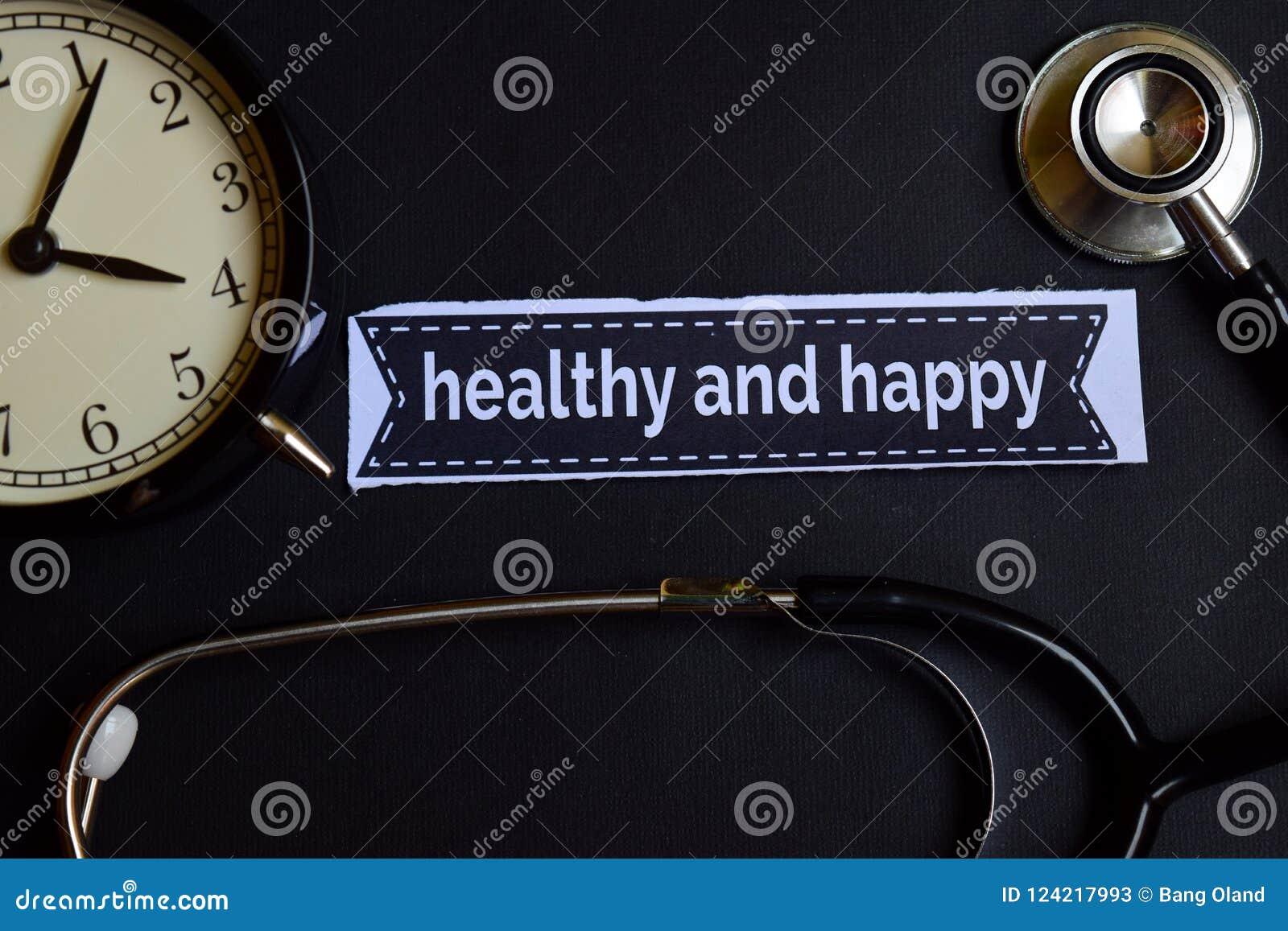 Sano y feliz en el papel de la impresión con la inspiración del concepto de la atención sanitaria despertador, estetoscopio negro