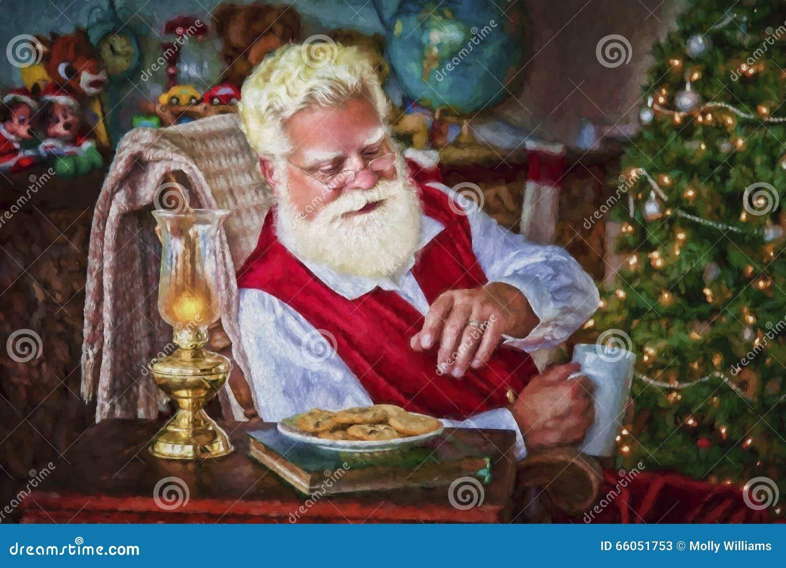 Santa avec les biscuits et le chocolat chaud