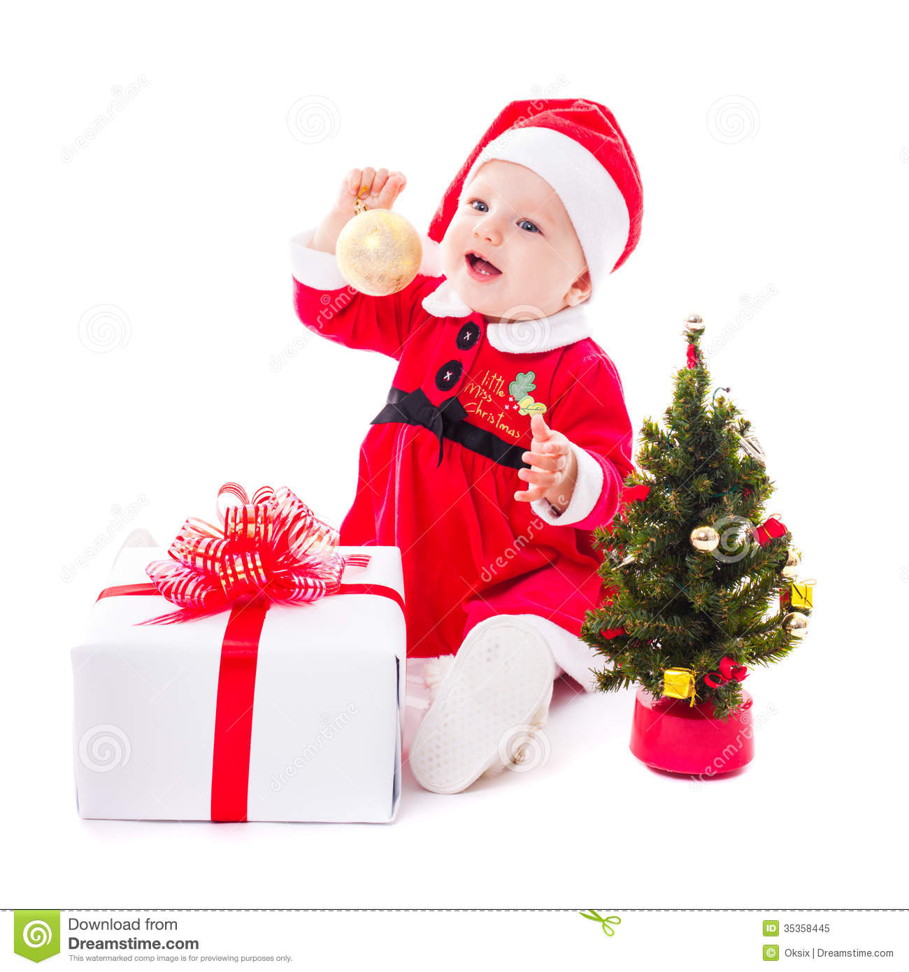 Santa baby girl with gold ball and christmas decorations on white