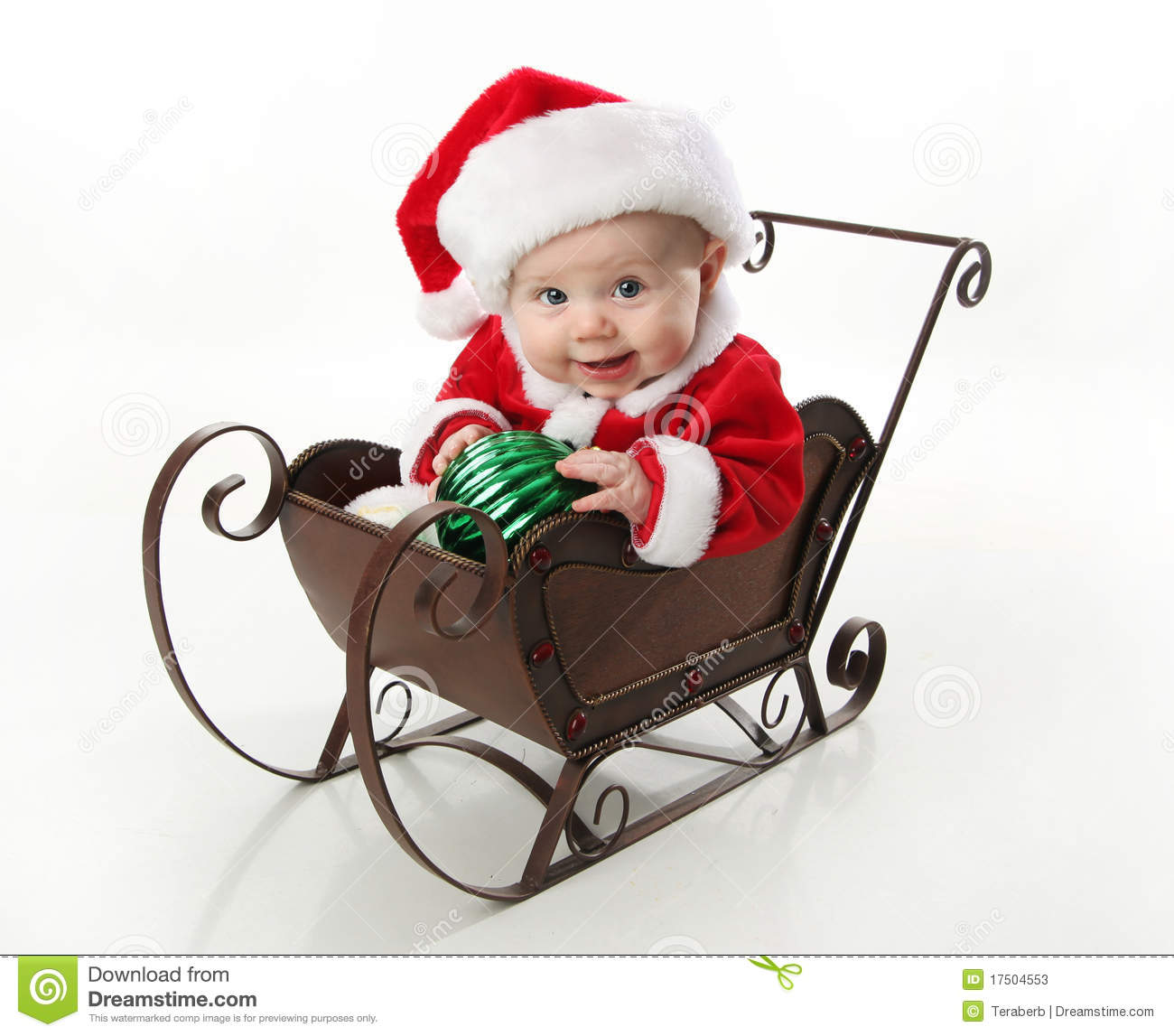 Santa sleigh ornament - Santa Baby Sitting In A Sleigh Stock Photos