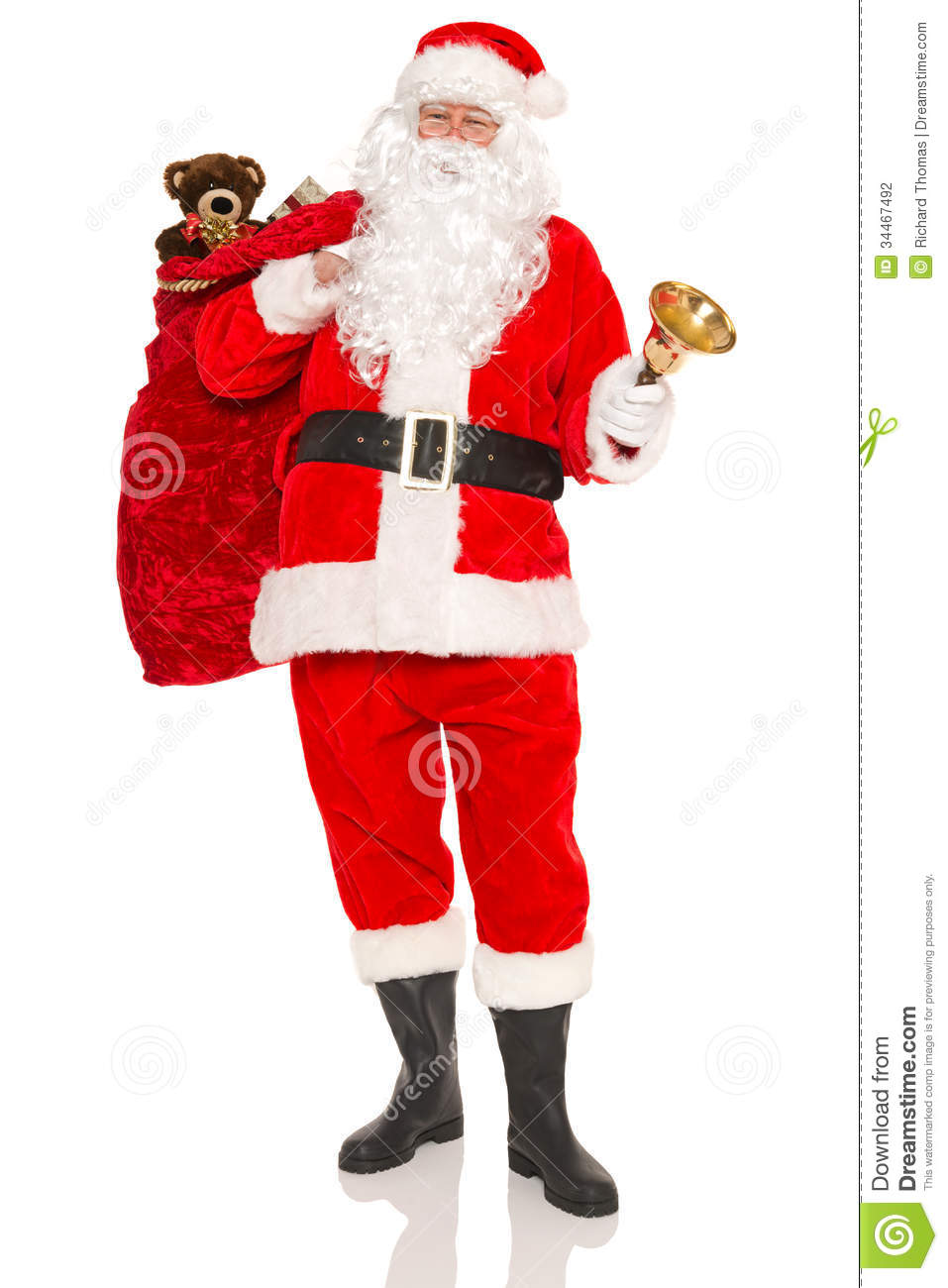 Presents Toys Christmas : Santa carrying a sack full of gifts isolated stock photo