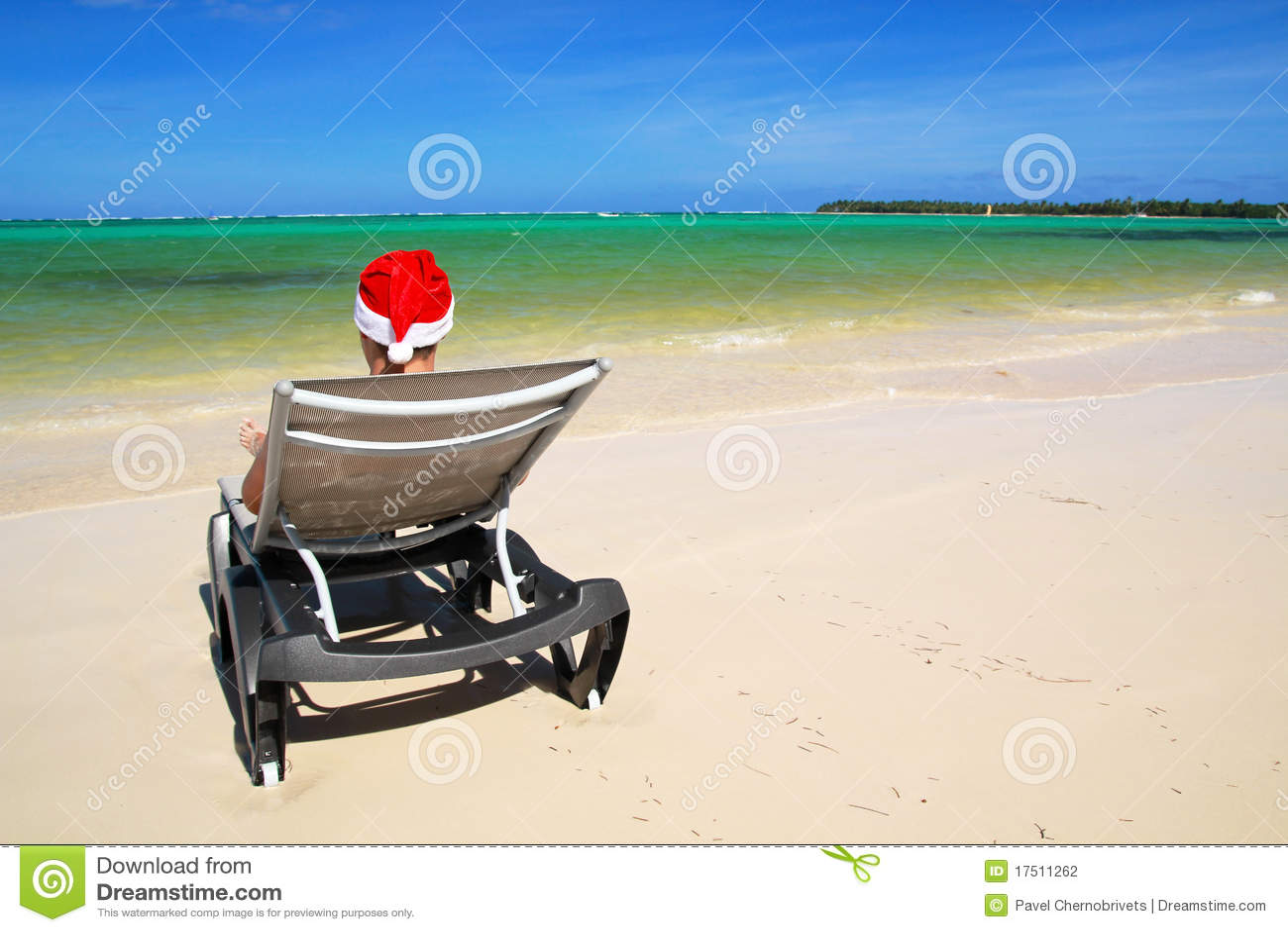 Santa on chaise longue on beach stock photography image for Beach chaise longue