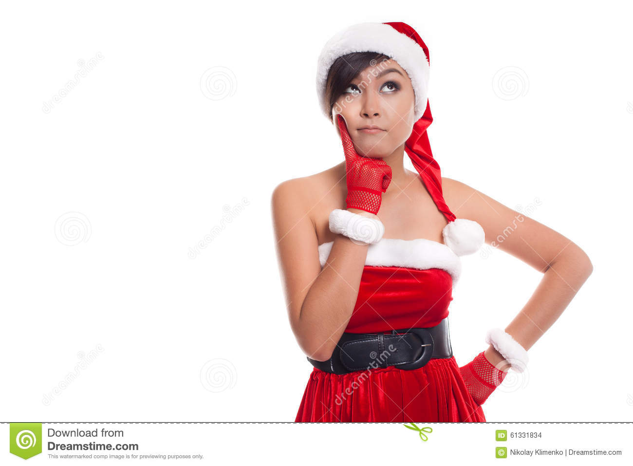 Santa christmas woman looking to the side thinking happy and playful. Asian christmas girl wearing santa hat and red sweater