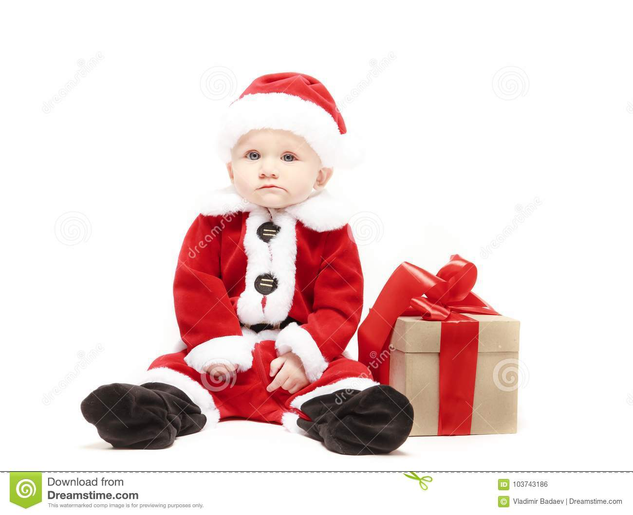 de5b1e276a18 Santa Claus baby in red christmas clothes with gift box isolated on white  background