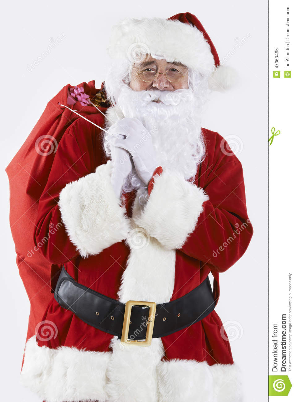 Santa claus holding carrying sack with gifts royalty free
