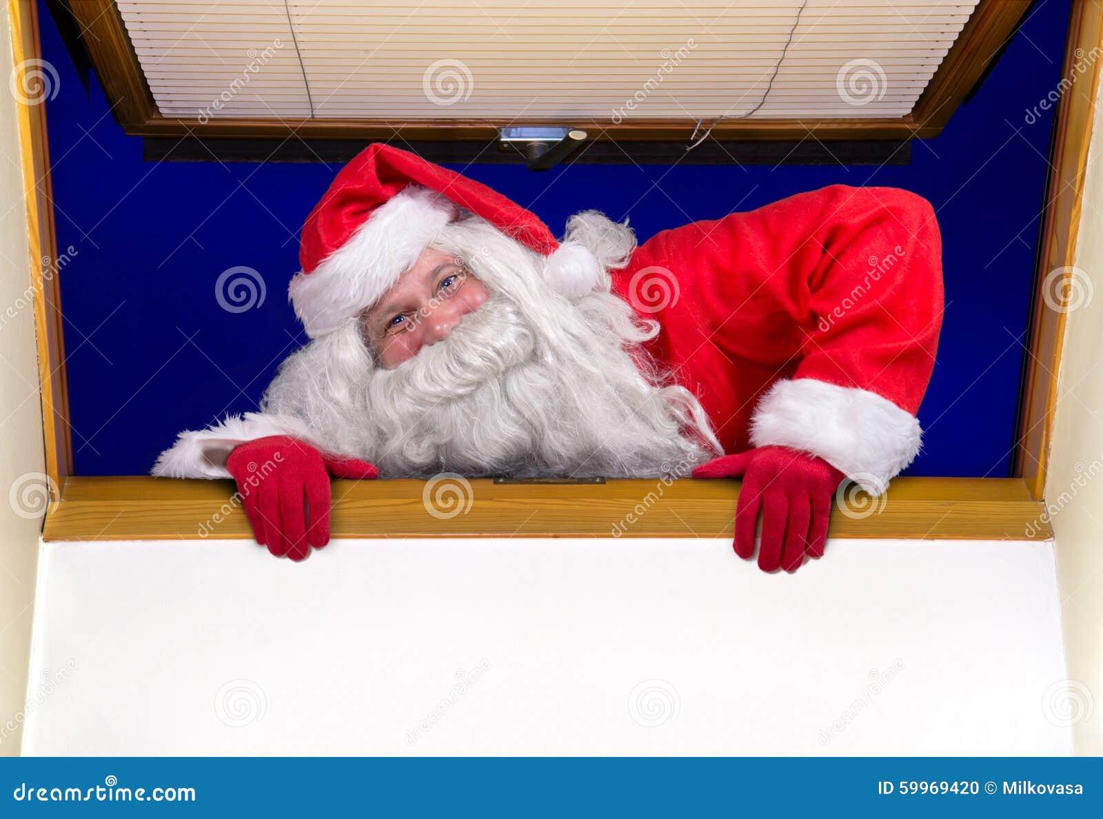 Santa Claus Climbs At Open Window Stock Photo Image