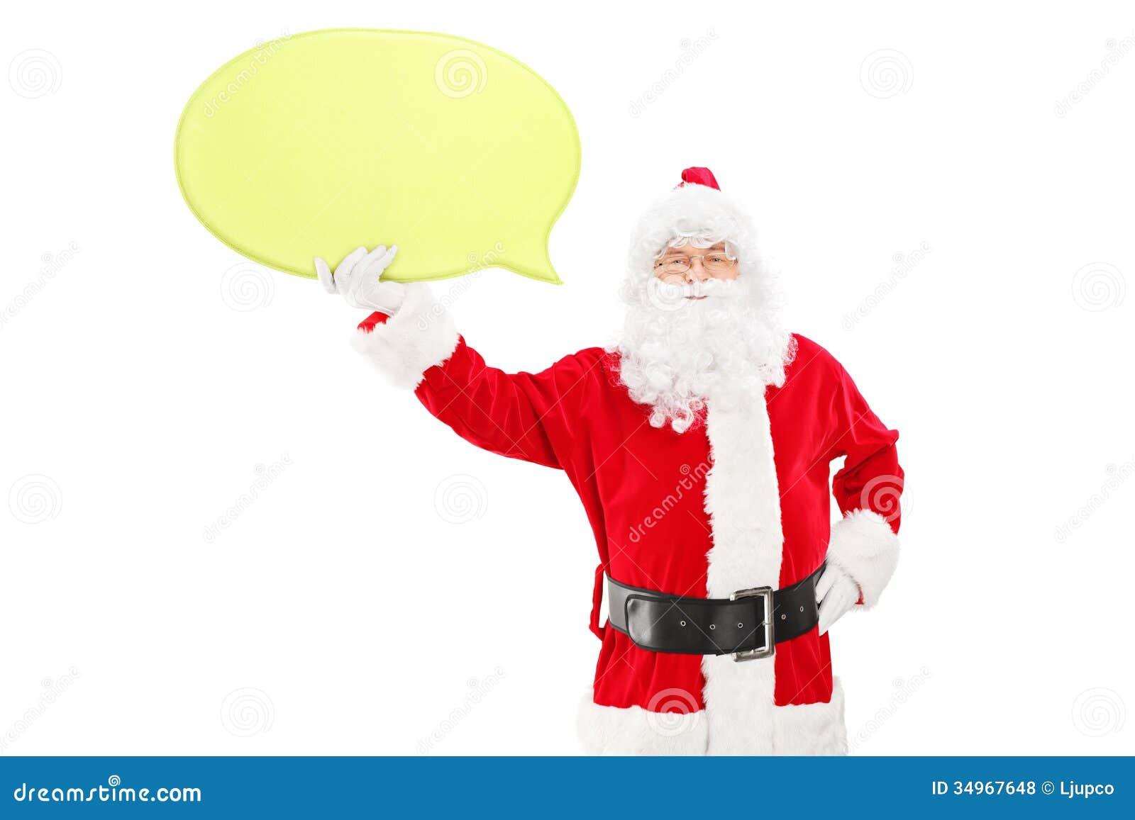 Santa Claus de sourire tenant un discours bouillonnent et regarder le camer