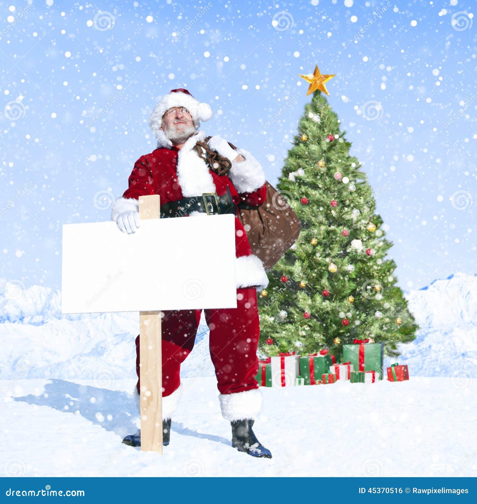 Santa Claus et plaquette vide avec l arbre de Noël