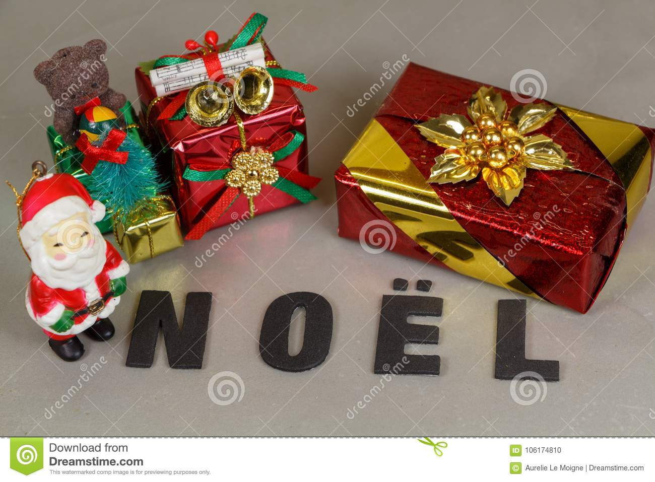 Santa Claus Figurine With Gifts And The Word Christmas Stock Photo ...