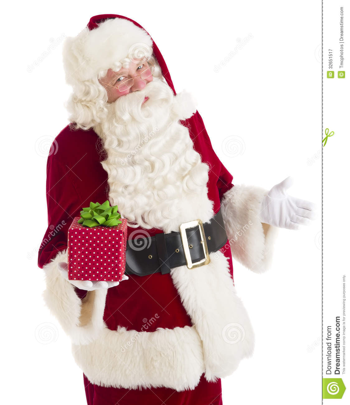 Santa claus gesturing while holding gift box stock image