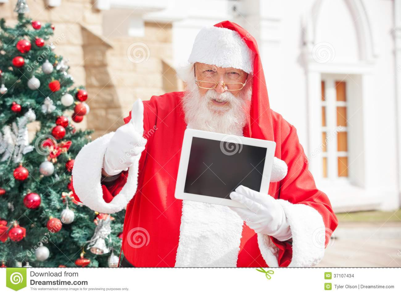 Santa Claus Gesturing Thumbsup While Holding