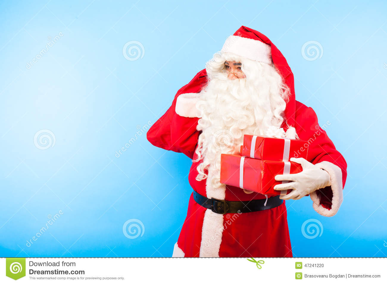 Santa Claus With Gifts On Hands On Blue Background Stock Photo ...