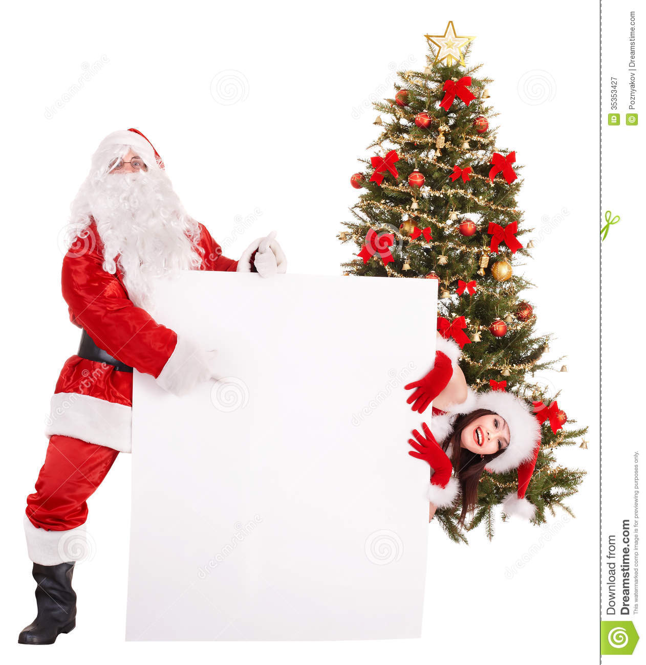 Santa claus and girl holding banner by christmas tree