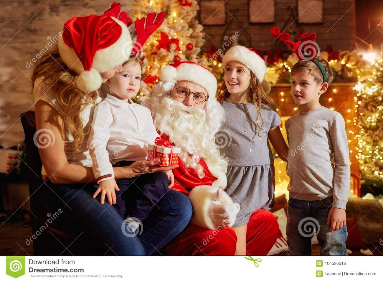 Santa Claus Gives Presents To Children On Christmas Day. Stock Photo ...