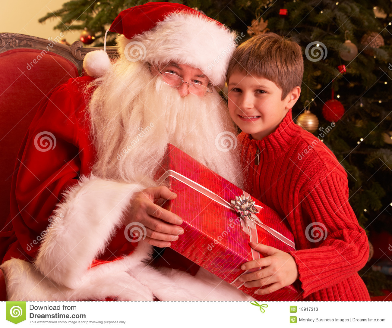 Santa Claus Giving Gift To Boy In Front Of Christm Stock ...