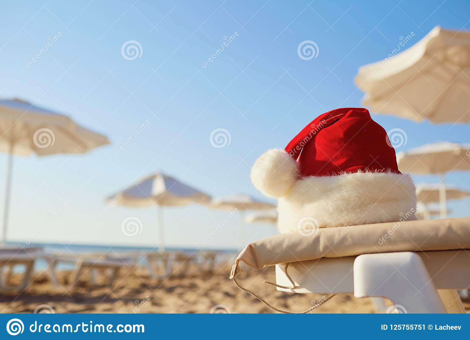 santa claus hat on the beach on christmas day - Beach Christmas Pictures