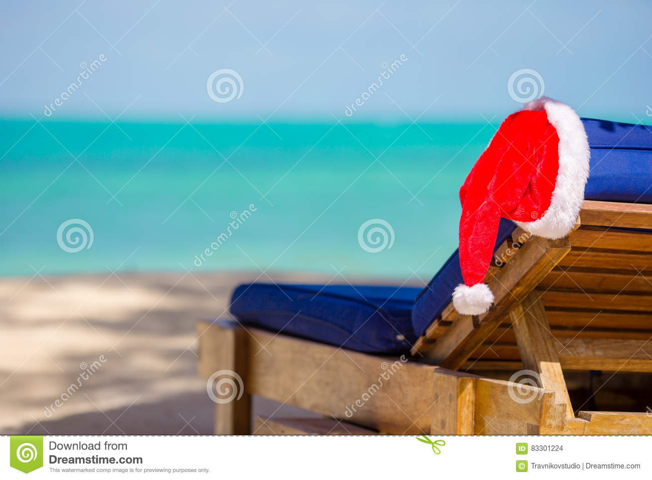 Santa Claus Hat On Beach Lounger With Turquoise Sea Water And White ...