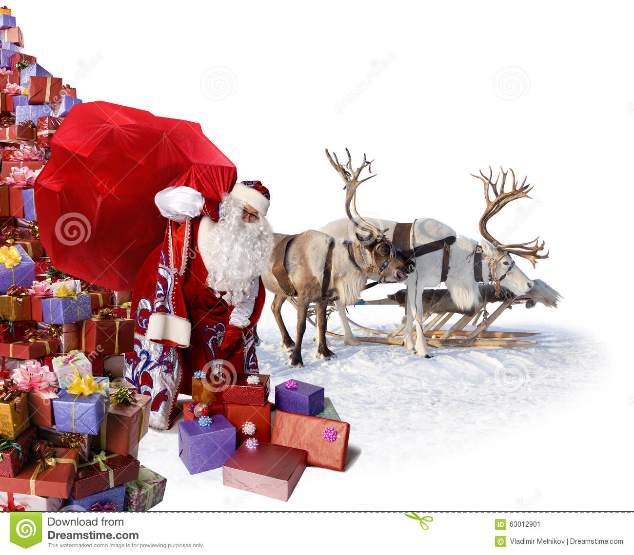 Santa claus and his reindeer with gifts stock photo