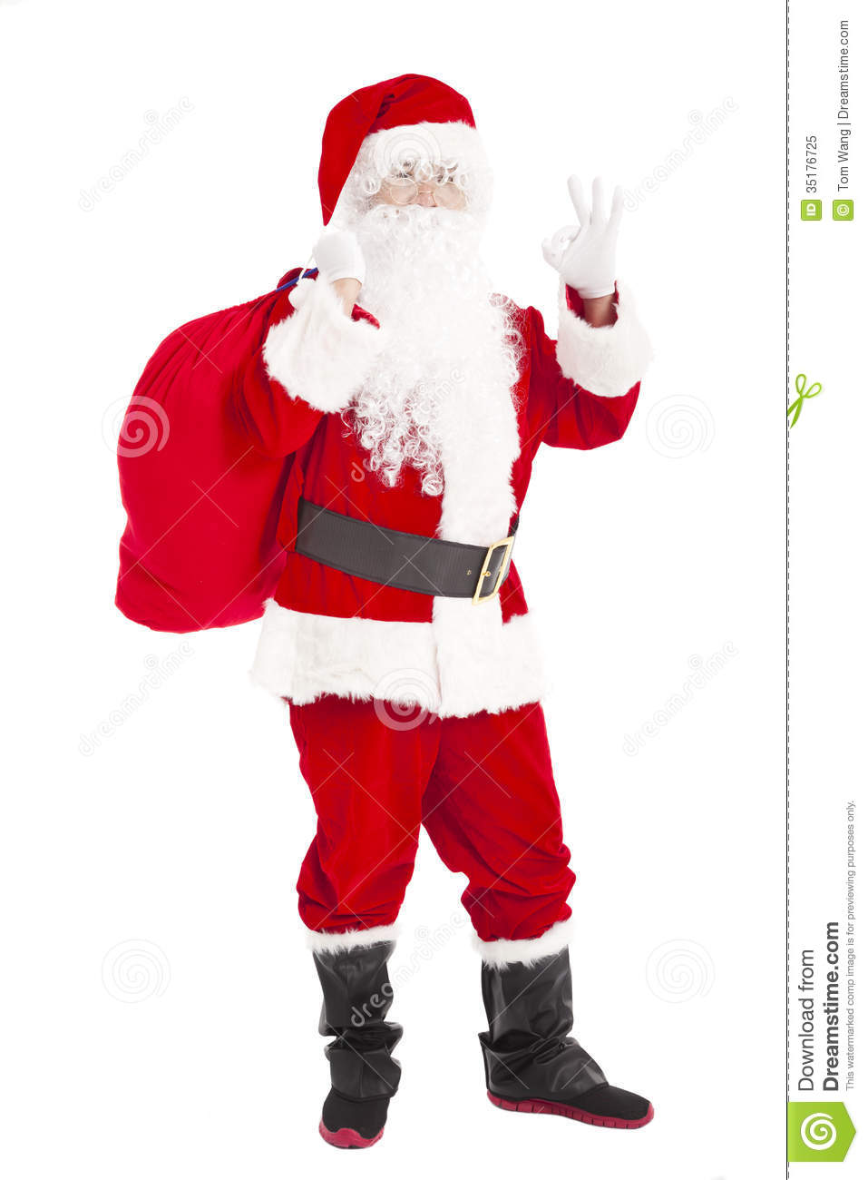 Santa claus holding gift bag with ok gesture stock image