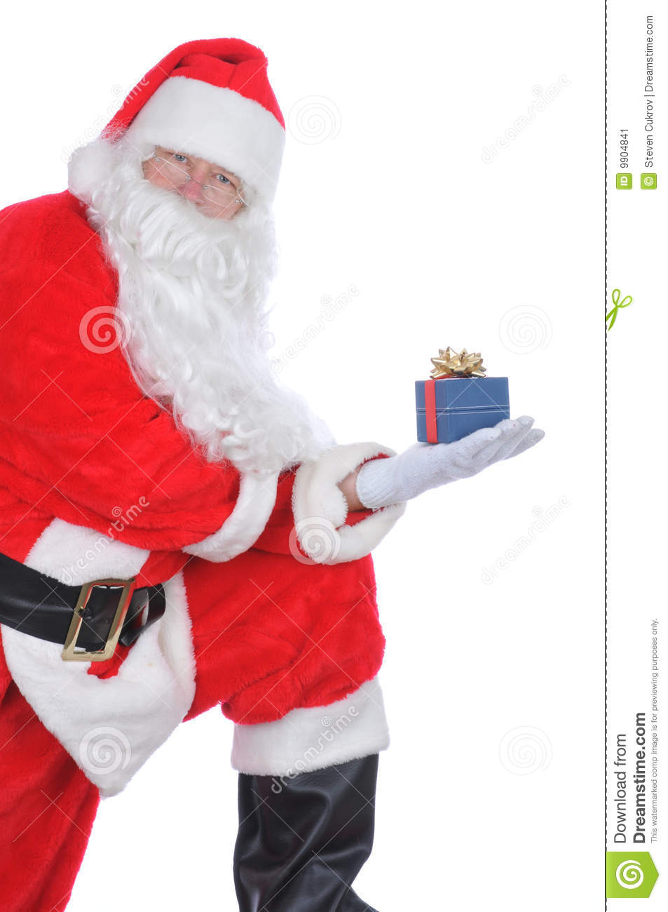 Santa Claus Holding A Present Stock Image Image 9904841