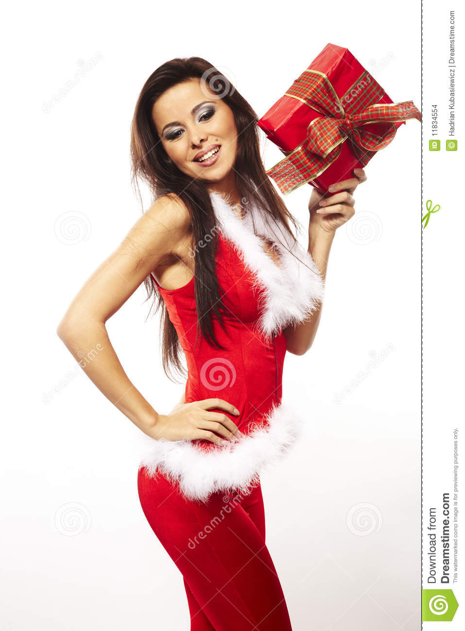 Santa claus and holding red gift on white