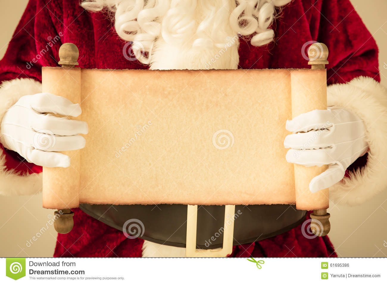Santa Claus holding scroll paper blank in hands. Christmas holiday ...