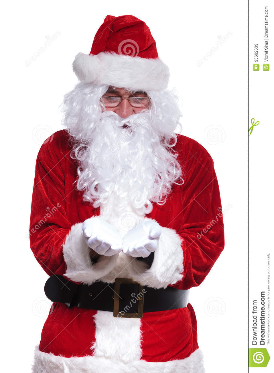 Santa claus is holding something on his hands