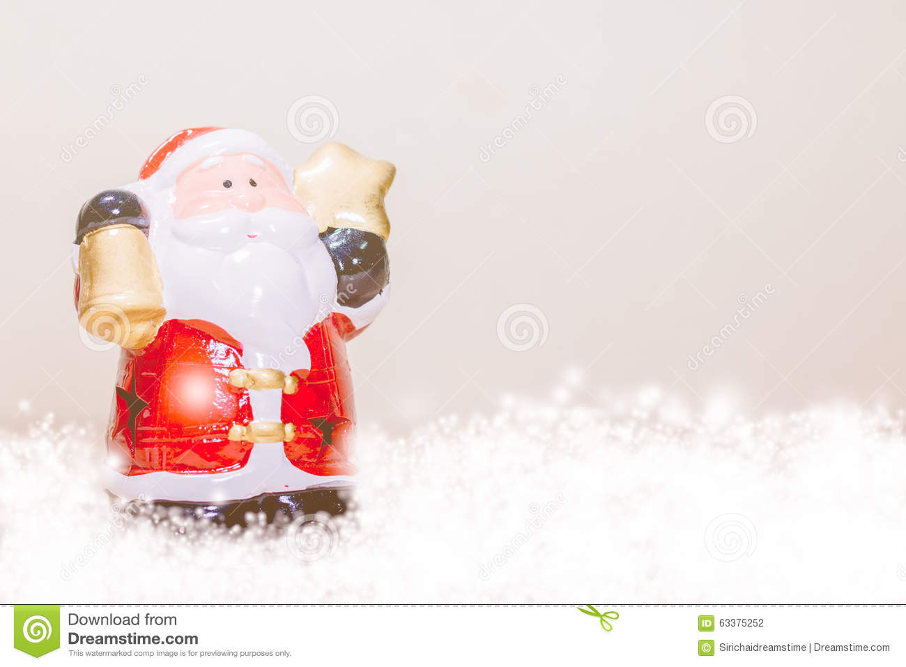 Santa claus holding star and bell stock photo image