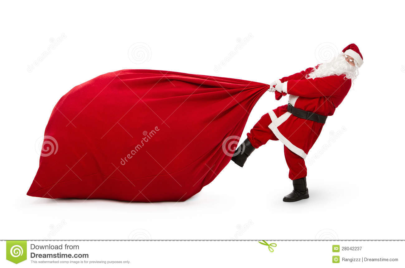 Santa claus with huge bag of presents stock image