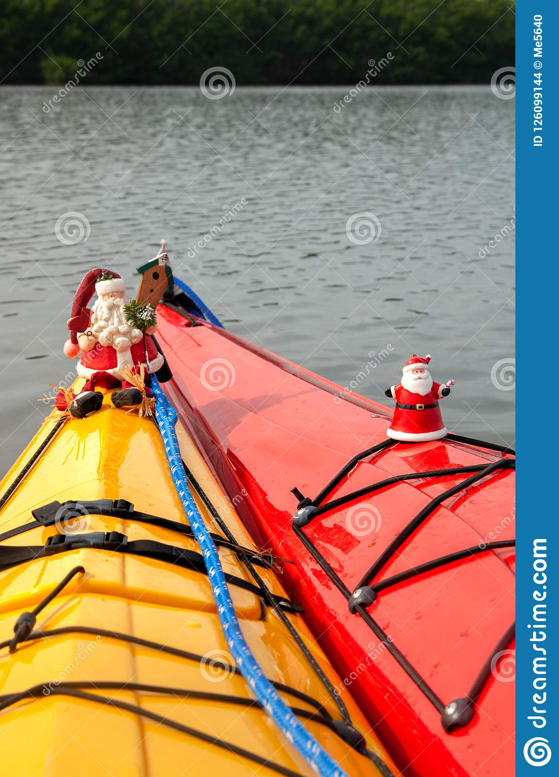 Santa Claus ornaments decorate holiday kayaks.