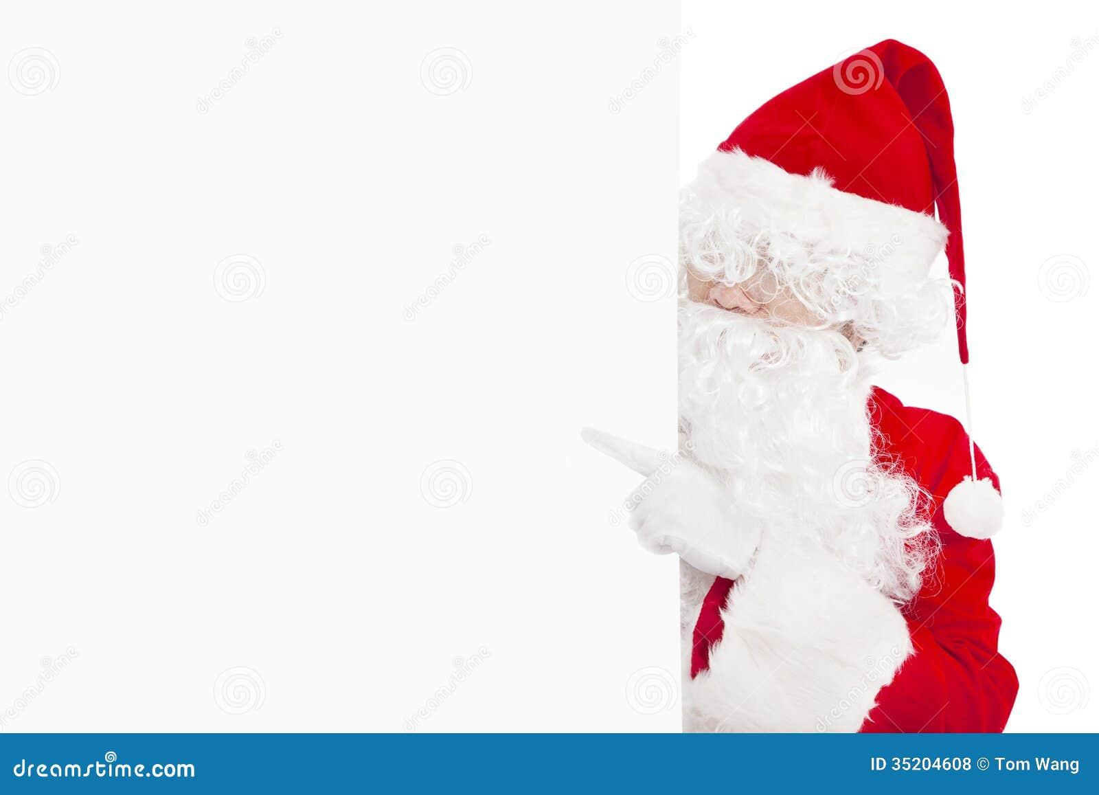 Santa claus pointing at blank banner royalty free stock