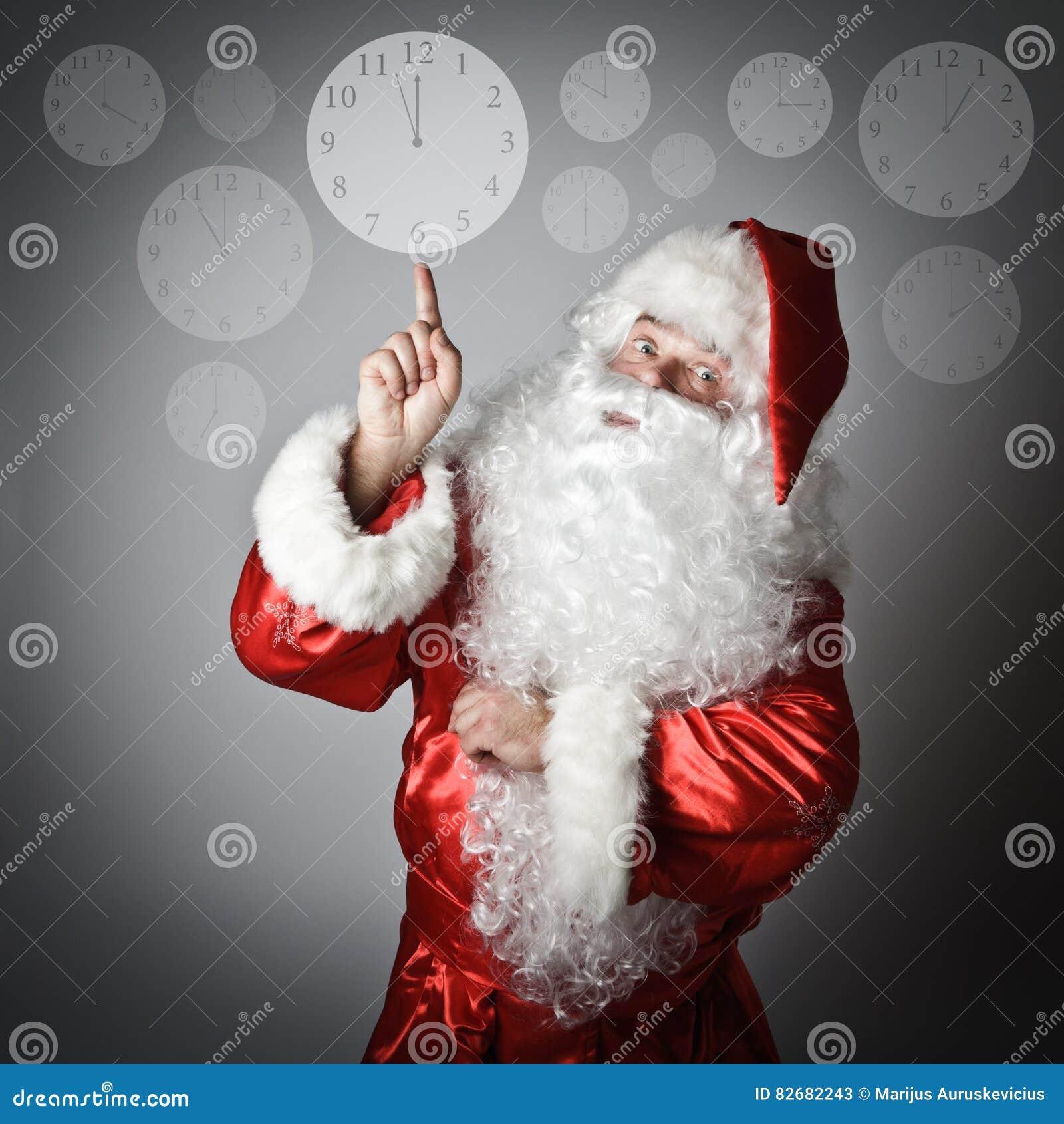 Santa Claus is pointing at the clock