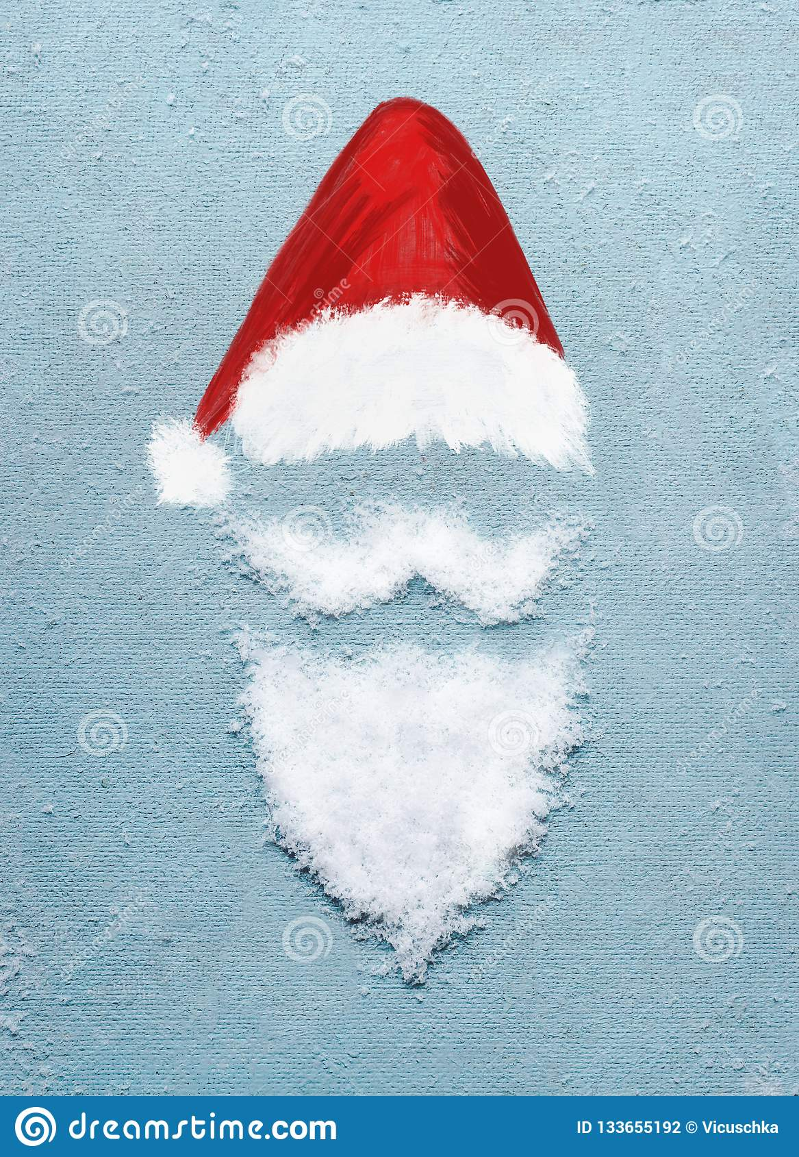 Santa Claus portrait symbol with painted Santa hat and beard with mustache  made with snow 37a32c9f00c