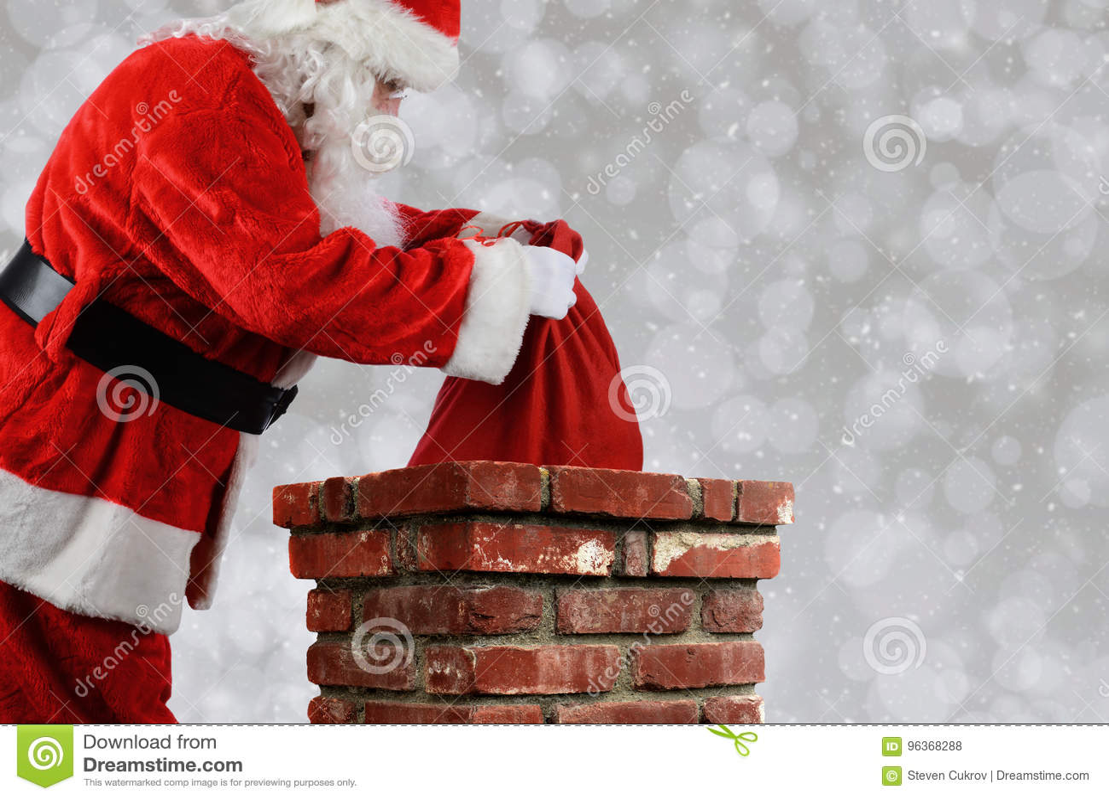 Santa Claus Putting Bag into Chimney