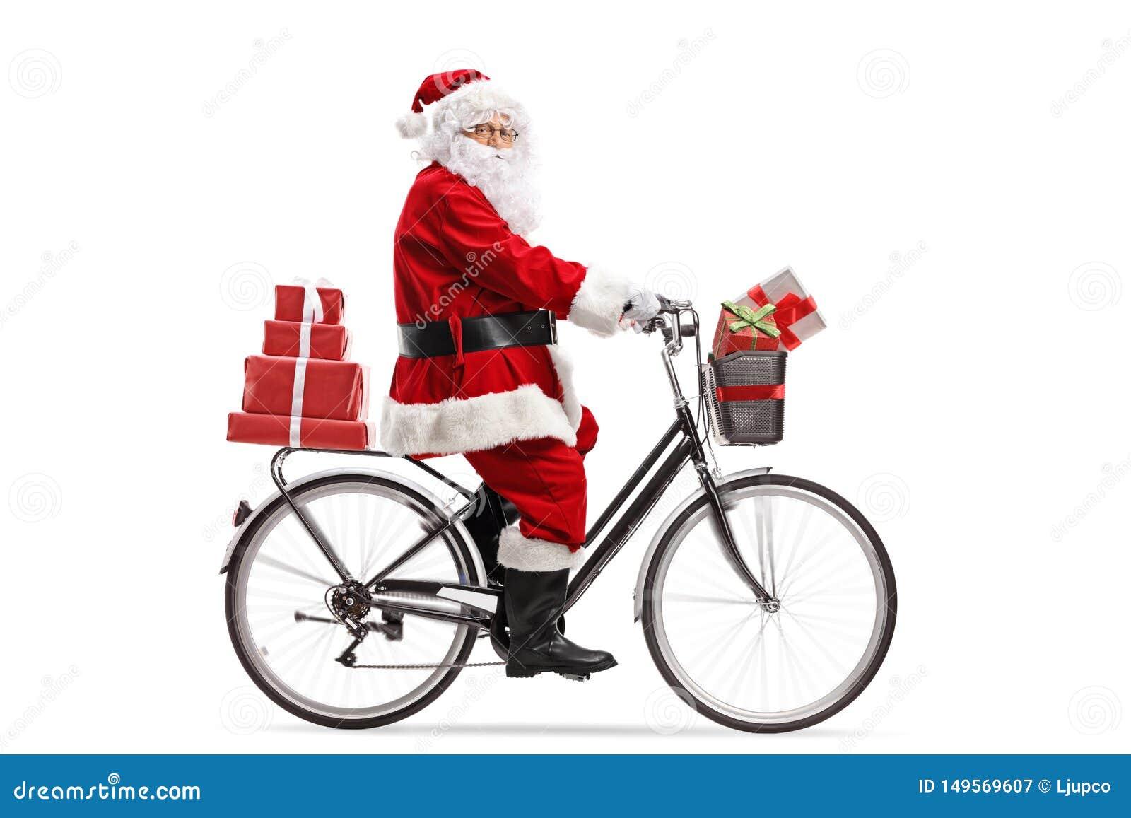 Santa Claus que monta uma bicicleta