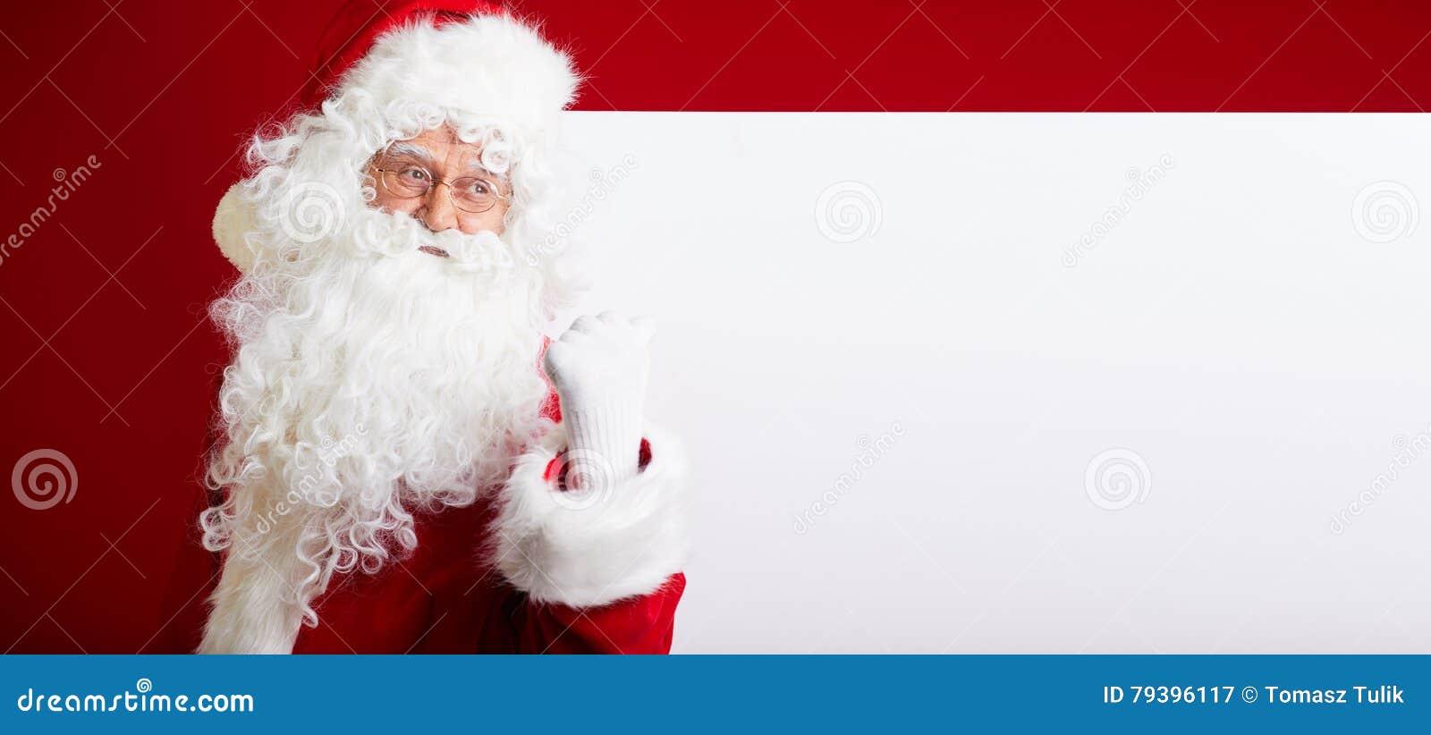 Santa Claus Que Señala En La Bandera En Blanco Del