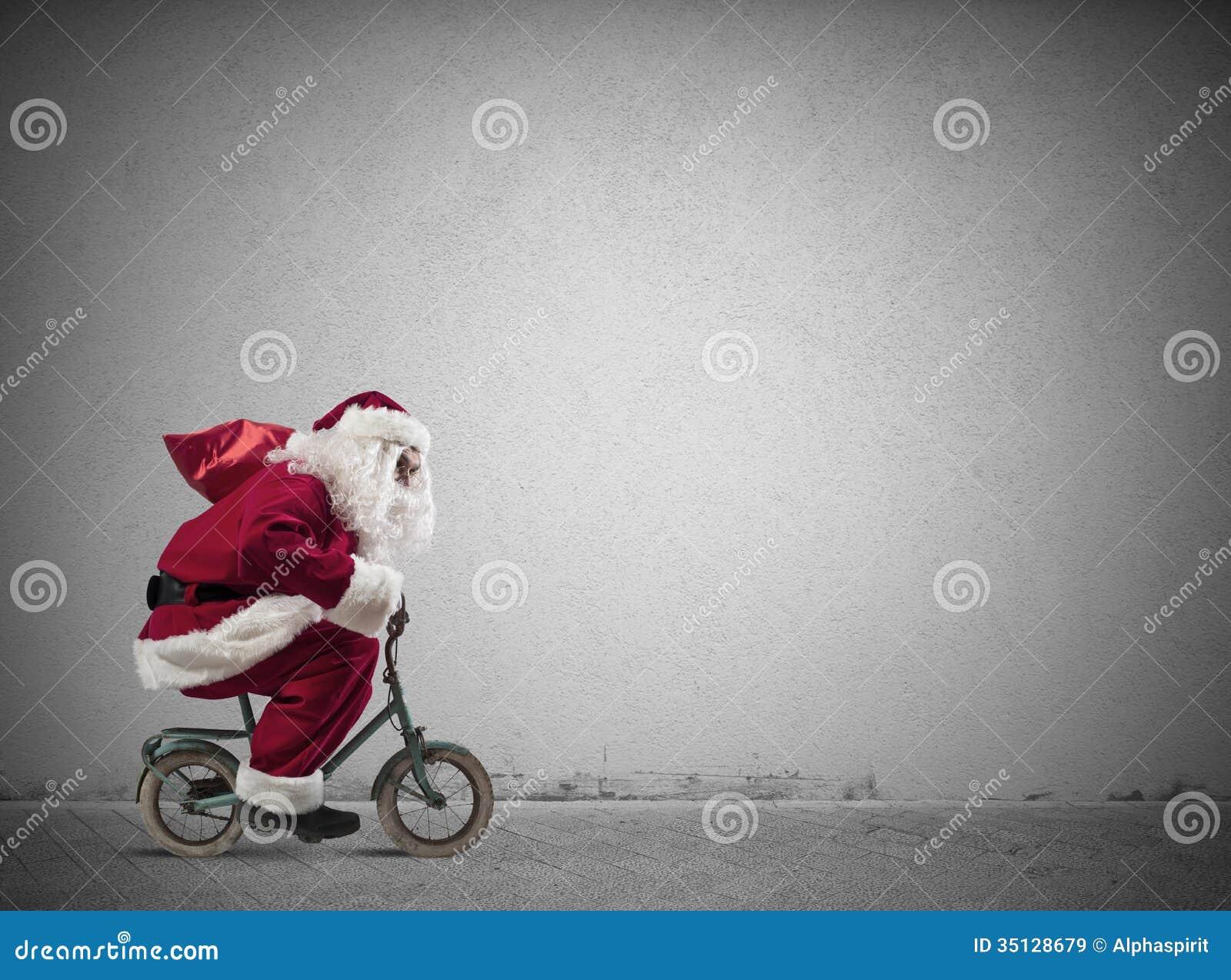 Santa Claus rápida na bicicleta