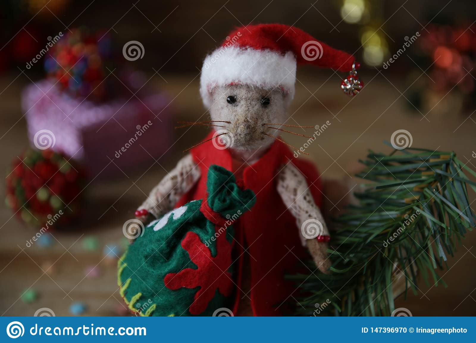 Chinese Christmas.Santa Claus Rat With A Bag Of Gifts And A Christmas Tree