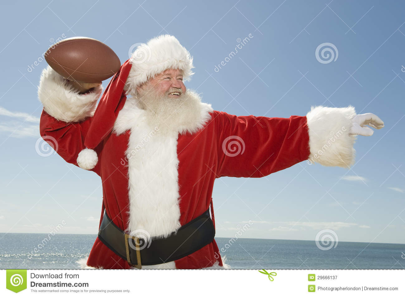 Santa claus ready to throw rugby ball royalty free stock