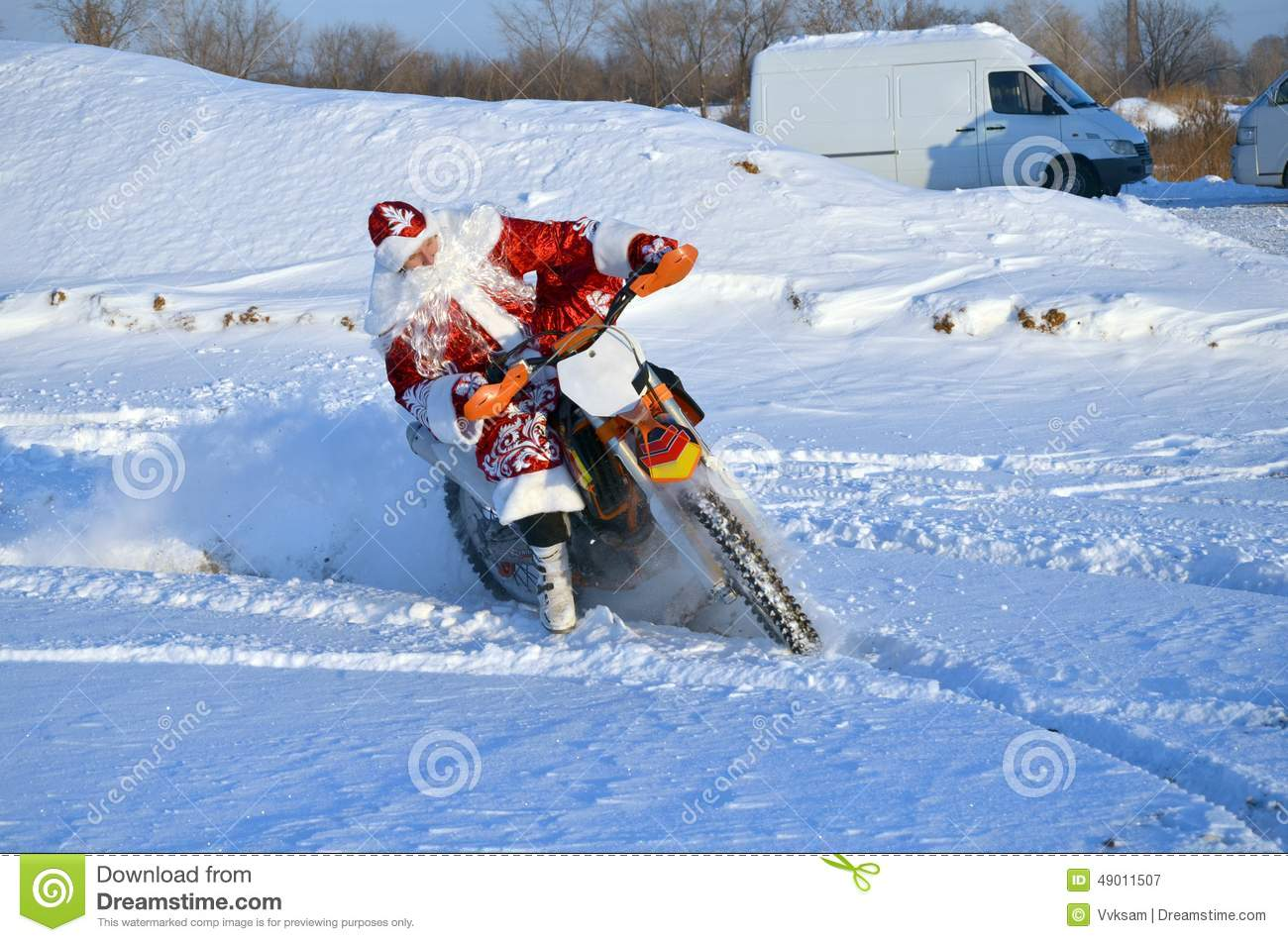 santa claus riding on a motorcycle turning mx stock photo