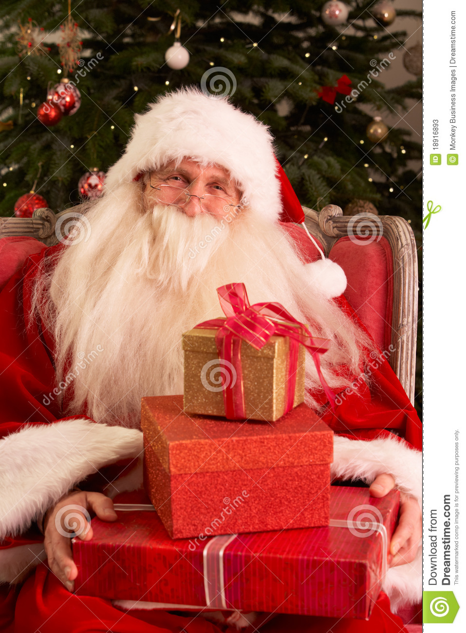 santa claus sitting in armchair stock image