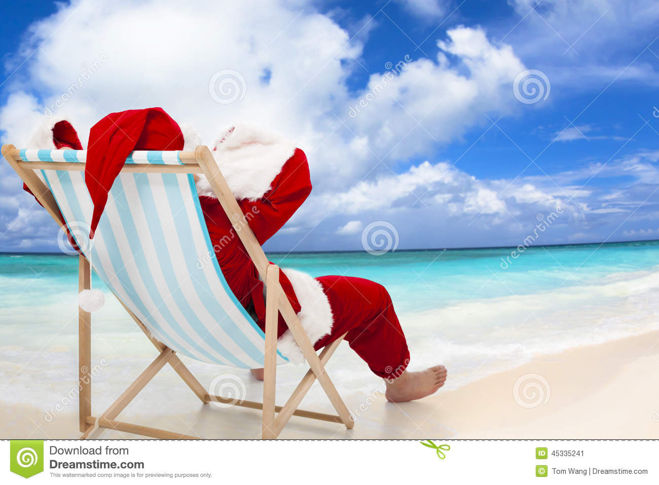 Santa Claus sitting on beach chairs with blue sky and cloud. Christmas ...