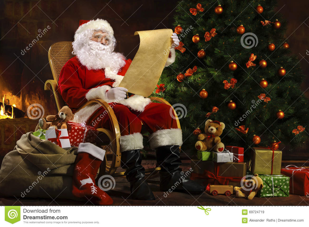 Santa Claus Sitting In Front Of Fireplace Stock Photo - Image ...
