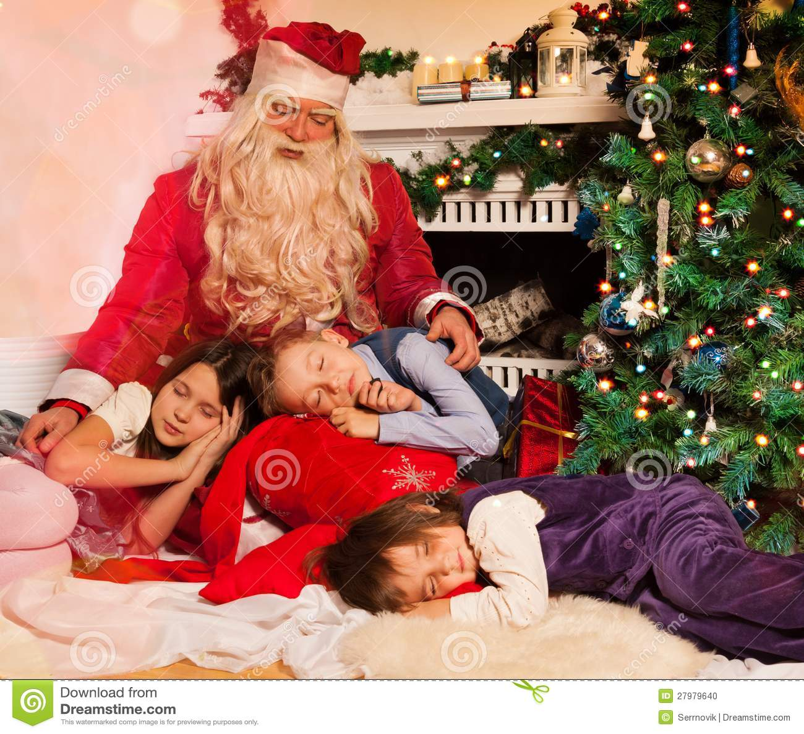 Santa claus and sleeping kids stock photo image