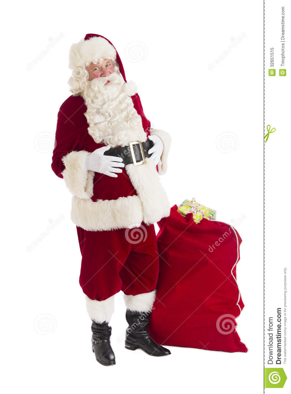 Santa claus standing with bag full of gifts royalty free