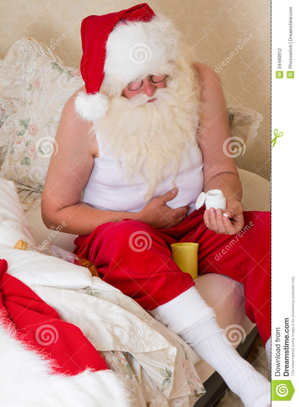 santa claus with stomach ache stock photo