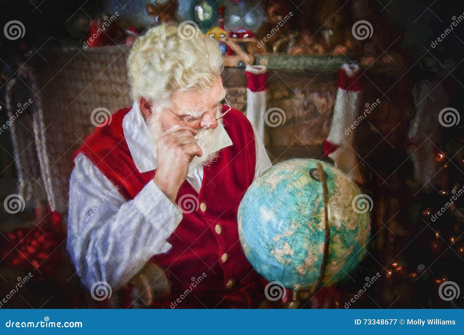 Santa Claus studying globe