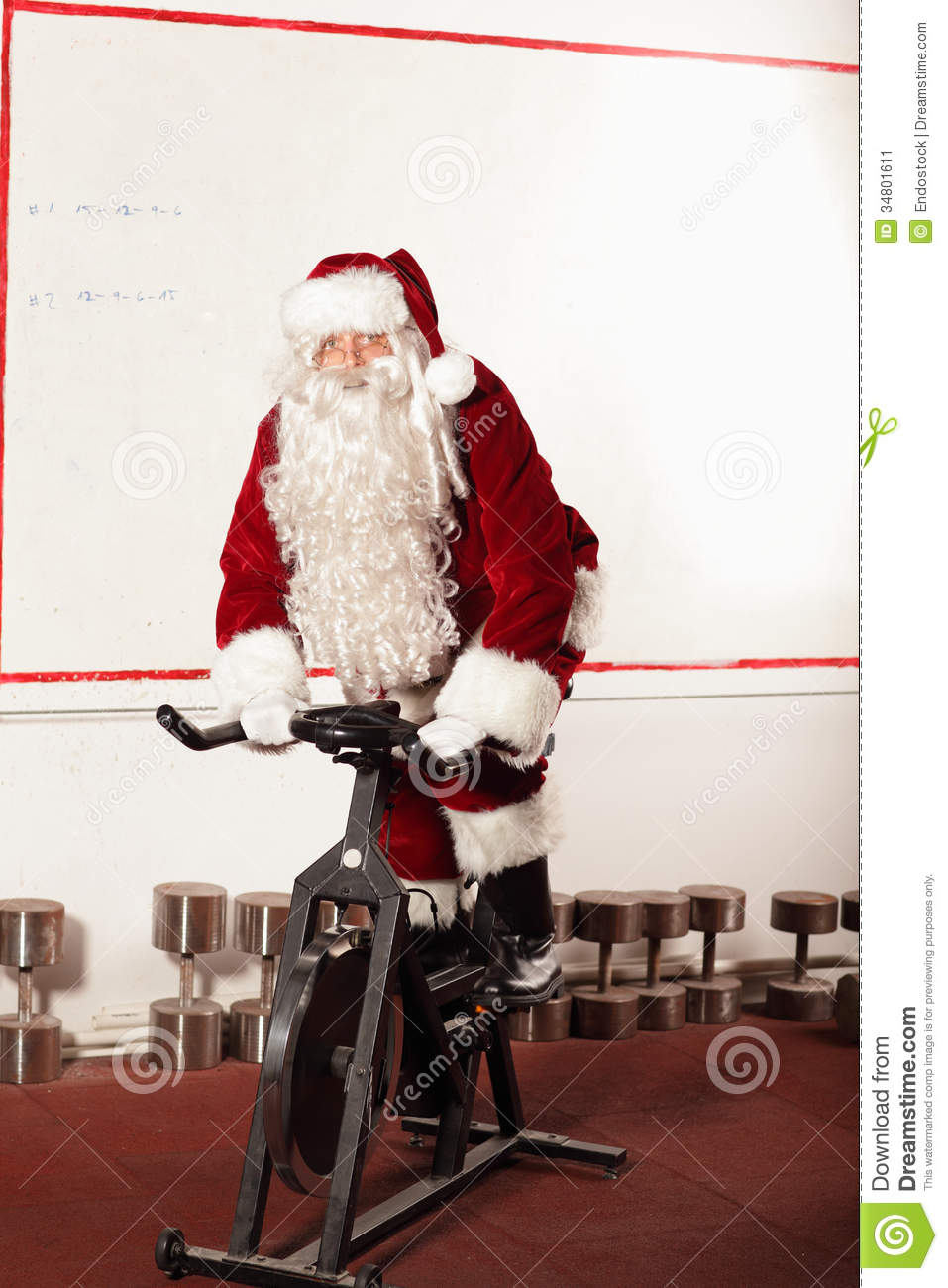 Santa Claus Training On Exercise Bike At The Gym Stock ...