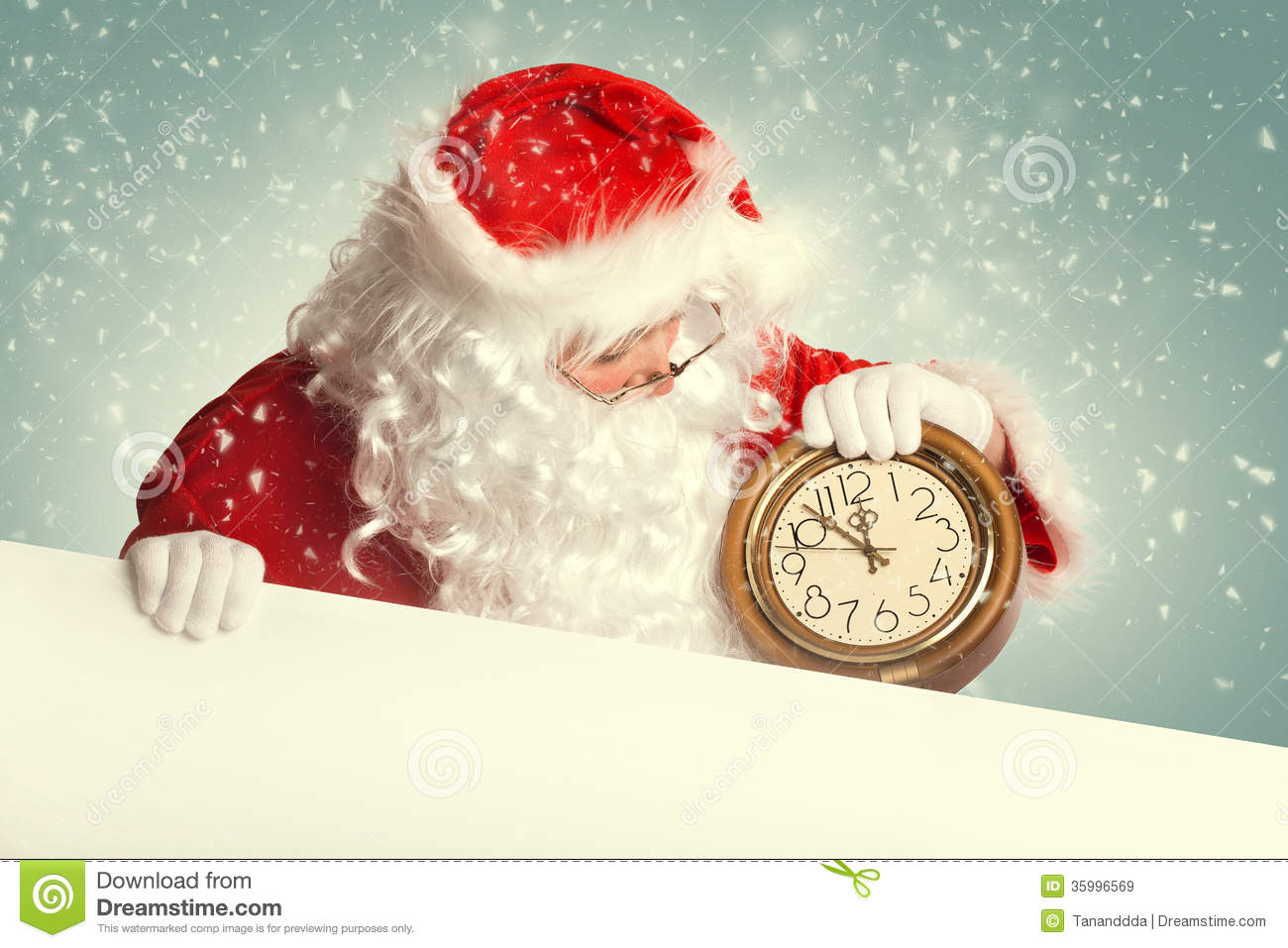 Santa claus with white blank banner holding a clock stock
